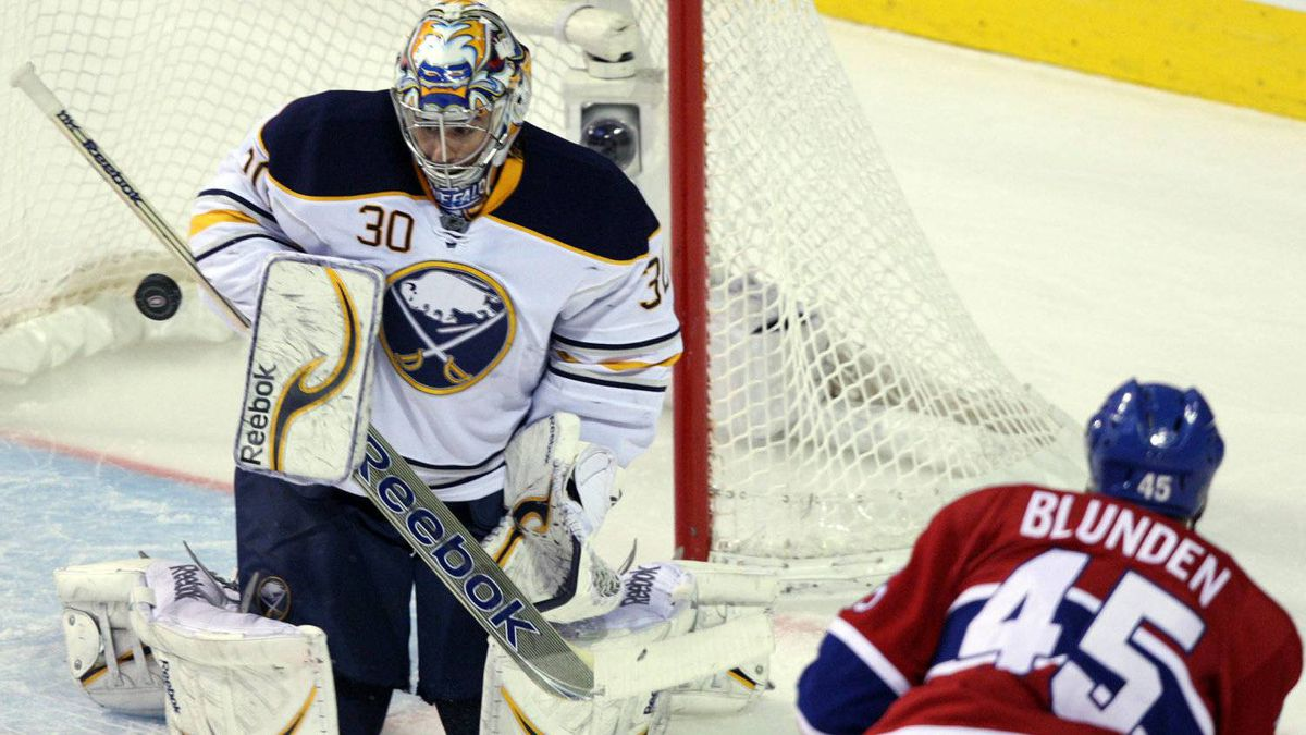 Buffalo Sabres goalie Ryan Miller makes a save against Montreal Canadiens right wing Michael Blunden.
