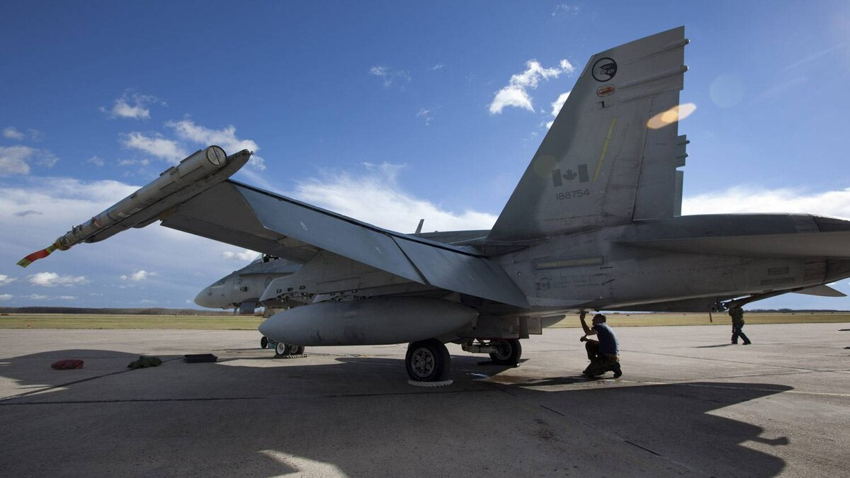 A CF-18 in CFB Cold Lake is given a routine inspection before take off.