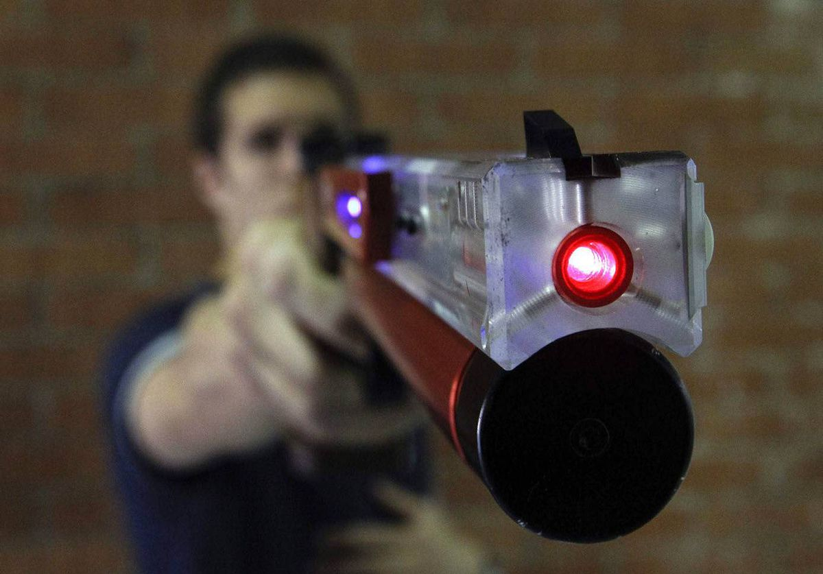Italian pentathlon athlete Pier Paolo Petroni shoots during a training session at the shooting range in Montelibretti, outside Rome. Laser guns will replace traditional air pistols in the modern pentathlon at the 2012 London Olympics.