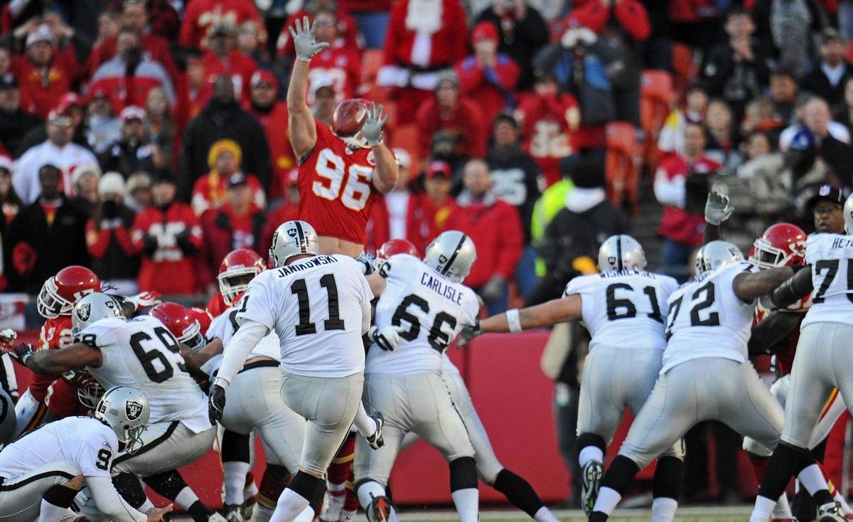 Place kicker Sebastian Janikowski of the Oakland Raiders kicks a 36-yard field goal against the Kansas City Chiefs to win the game in overtime on December 24, 2011 at Arrowhead Stadium in Kansas City, Missouri. Oakland defeated Kansas City 16-13 in overtime.