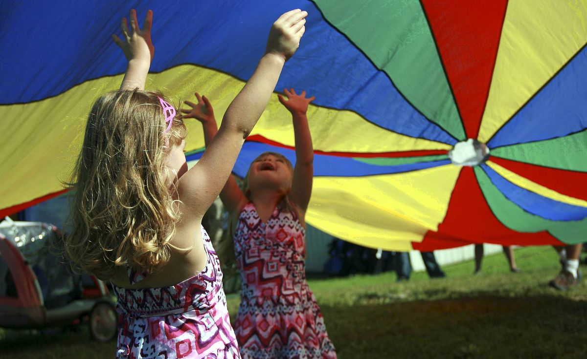 Julie Grenier sent us this photo. Cousins Mackenzie, 4, and Avery, 3, decked out in matching dresses, enjoy the wonders of a parachute at a family reunion in Cypress River, Man.