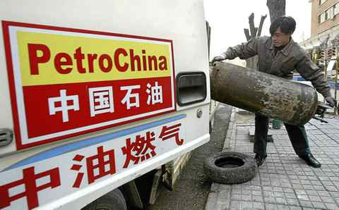 A PetroChina worker loads cannisters of liquified petroleum gas onto a truck in Beijing.