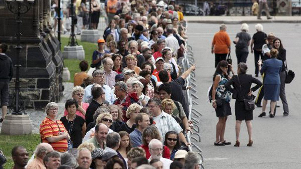 Crowds line-up to pay respect to Canada's leader of the Opposition Jack Layton as his body lies-in-state in the Center Block of Parliament Hill in Ottawa on Aug. 24, 2011.