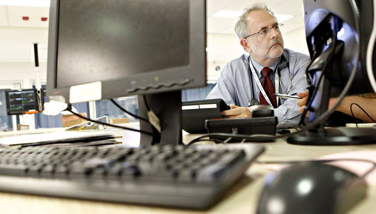 Dr. Adam Cwinn, head of the Emergency Medicine department at the Ottawa Hospital General Campus, utilizes technology to make his job more efficient