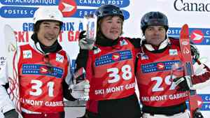 Gold medallist Pavel Krotov of Russia, flanked by silver medalist Canadian Olivier Rochon, right, of Gatineau, Que. and bronze medallist Naoya Tabara of Japan celebrate on the podium at the men's aerials World Cup freestyle event Sunday, January 15, 2012 at Mont-Gabriel in Sainte-Adele, Que. THE CANADIAN PRESS/Jacques Boissinot