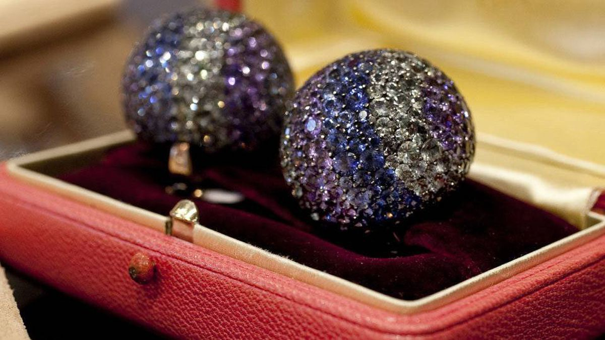 Elizabeth Taylor's diamond and multi-colored sapphire Ball ear clips, estimated at $100,000 to $150,000.