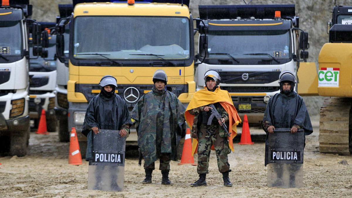 Peruvian police officers guard vehicles and machinery of Newmont's proposed $4.8-billion Conga gold mine to protect it from protesters near the Cortada lagoon in the Andean region of Cajamarca.