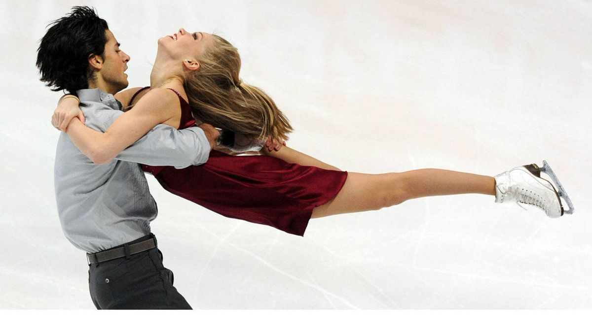 Kaitlyn Weaver (R) and Andrie Poje of Canada perform during their ice dance free dance of the ISU Grand Prix figure skating series at the Megasport arena in Moscow on November 26, 2011.