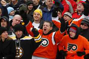 Fans cheer during the game between the Philadelphia Flyers and the Boston Bruins during the 2010 Bridgestone Winter Classic at Fenway Park on January 1, 2010 in Boston, Massachusetts. (Photo by Jim McIsaac/Getty Images)