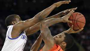 Louisville's Chane Behanan looks to shoot over Kentucky's Darius Miller, left, during the second half of an NCAA Final Four semifinal college basketball tournament game Saturday, March 31, 2012, in New Orleans. (AP Photo/Mark Humphrey)