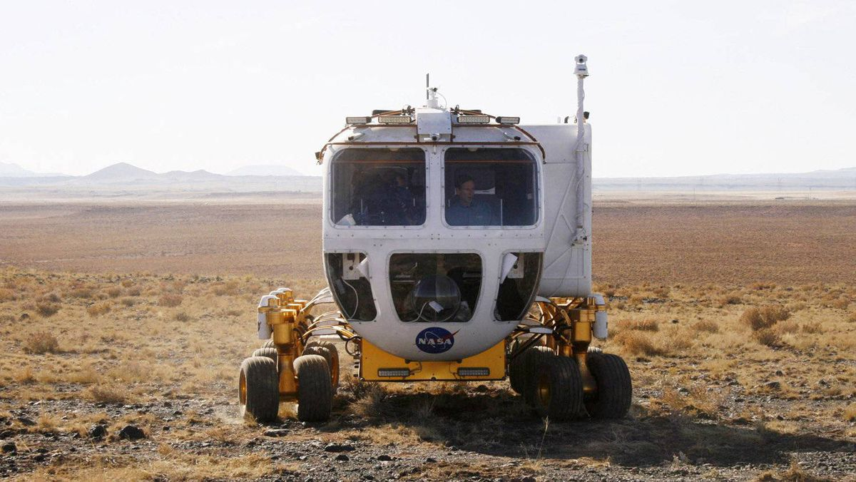 A new lunar rover vehicle that U.S. space agency NASA is testing goes through its paces in Black Point, Arizona, October 24, 2008. The Small Pressurized Rover Concept vehicle is designed to carry two astronauts without space suits, sitting in a pressurized compartment, when NASA returns to lunar exploration by 2020. The vehicle is being tested in a remote corner of Arizona with similar surface conditions to those found on the moon. It has a range of up to 625 miles (1,000 km).