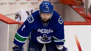 Vancouver Canucks' Dan Hamhuis hangs his head after losing to the Los Angeles Kings during the first overtime period of game 5 of the Western Conference quarterfinal in Vancouver, B.C., on Sunday April 22, 2012.