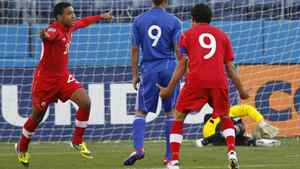Evan James of Canada scores past goalkeeper Odisnel Cooper of Cuba during their CONCACAF Olympic qualifying soccer match in Nashville, Tennessee.