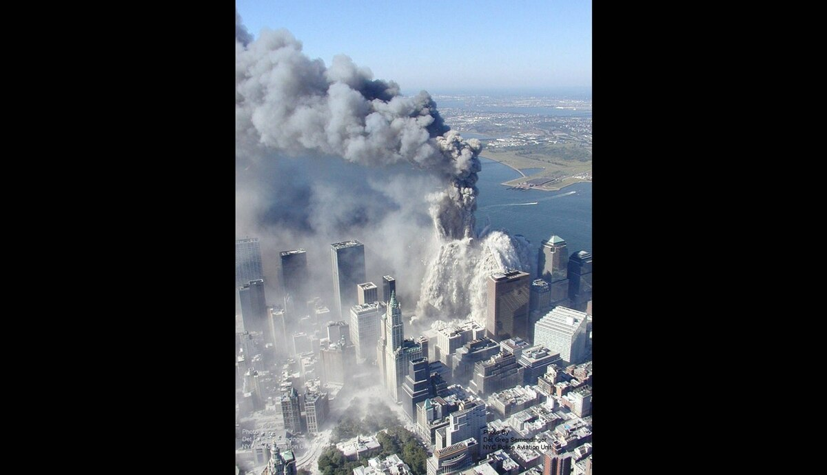 The first World Trade Center tower begins to implode in New York, after terrorists flew two airliners into the towers.