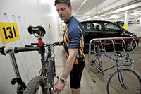 Shawn Bravender, 41, an associate in the planning department of Stantec in Edmonton tweaks his bike on the company repair station in the parkadae below Stantec.