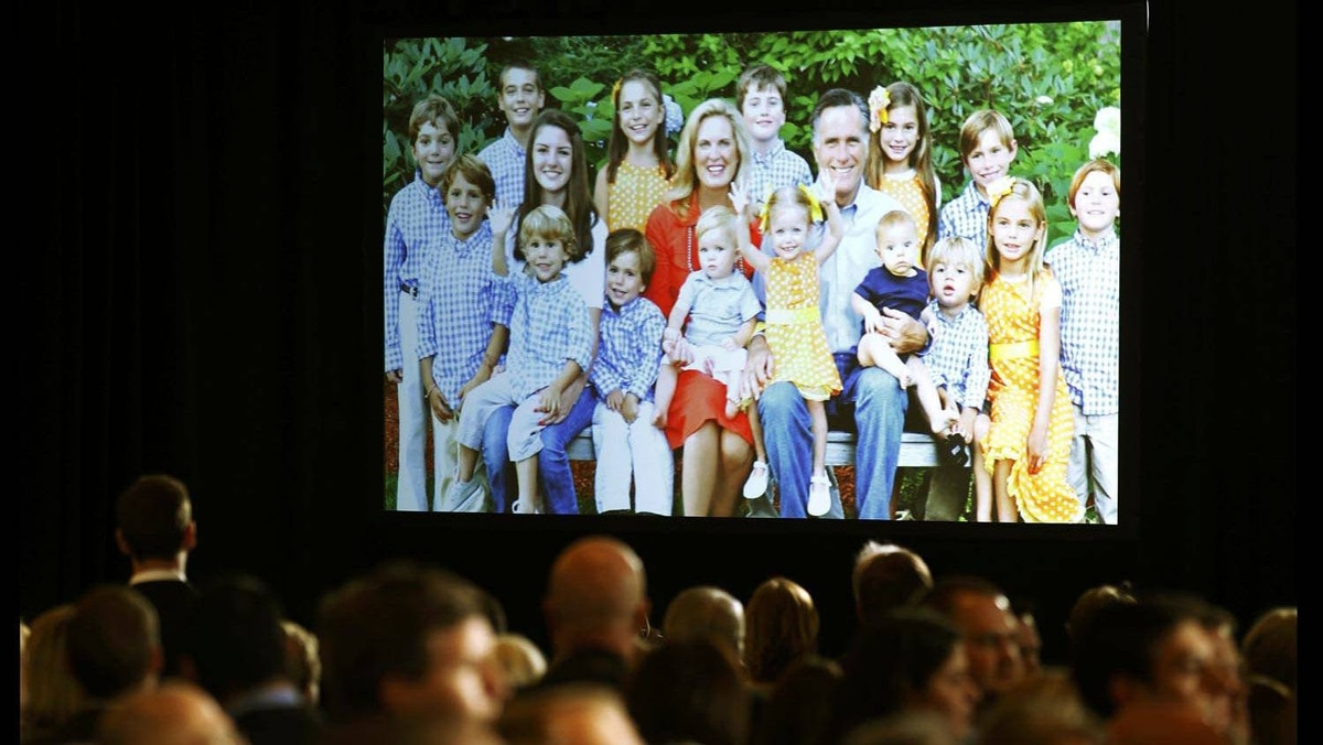 A video screen displays archive images of Republican U.S. presidential candidate Mitt Romney, his wife Ann and family members at his Super Tuesday primary election night rally in Boston on March 6, 2012.