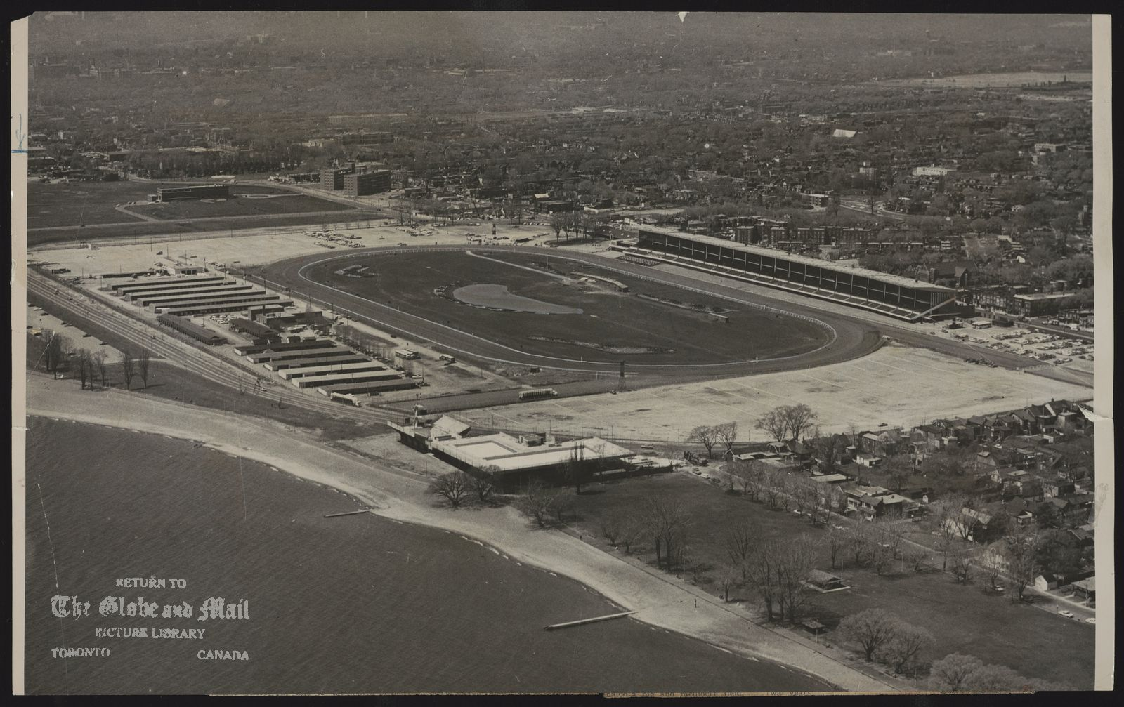 BEACHES OLYMPIC SWIMMING POOL (Toronto) Air view locking northwest from lakefront at foot of Woodbine Ave. indicates areas available for Oympic pool parking and other spectator problems. Used May 30, 1963 p.27
