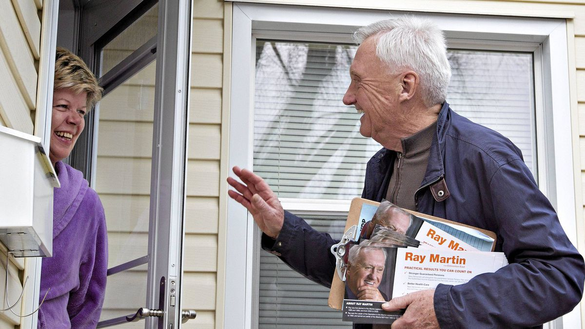 NDP candidate Ray Martin talks with Norma Ayott as he canvasses in the Virginia Park neighbourhood of Edmonton April 25, 2011.