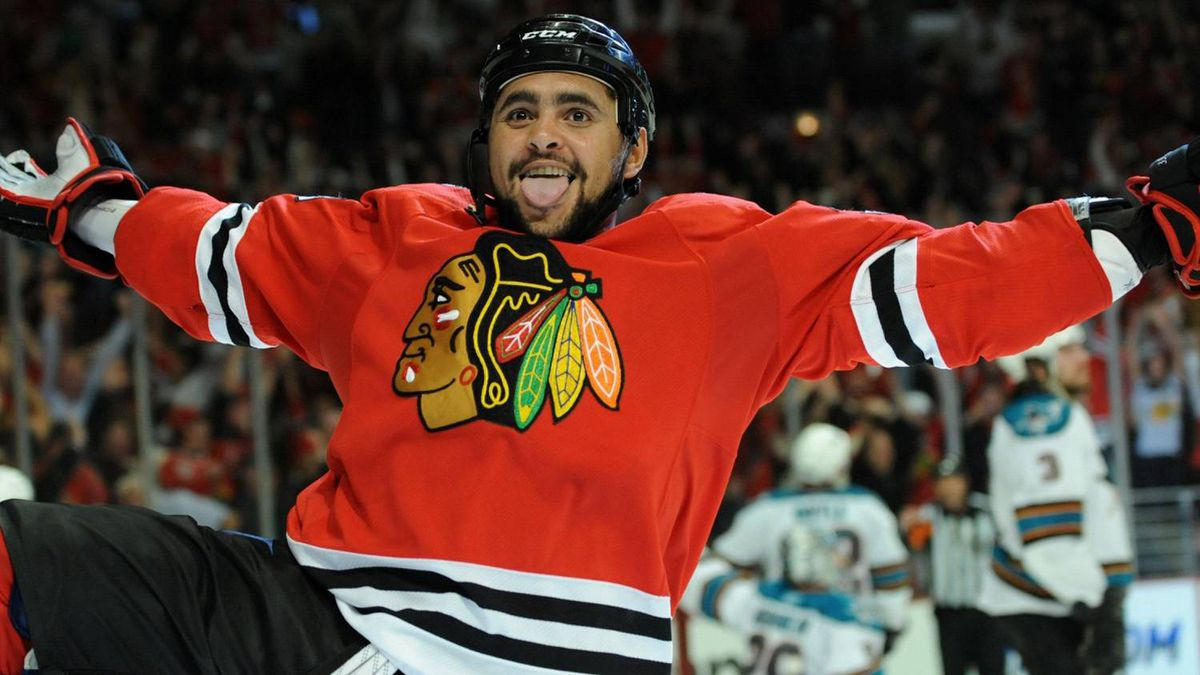 Chicago Blackhawks' Dustin Byfuglien acknowledges the fans after scoring the game winning goal against San Jose Sharks in the overtime of Game 3 of an NHL hockey Western Conference finals Friday, May 21, 2010, in Chicago. The Blackhawks won 3-2 in overtime. (AP Photo/Chicago Sun-Times, John J. Kim)