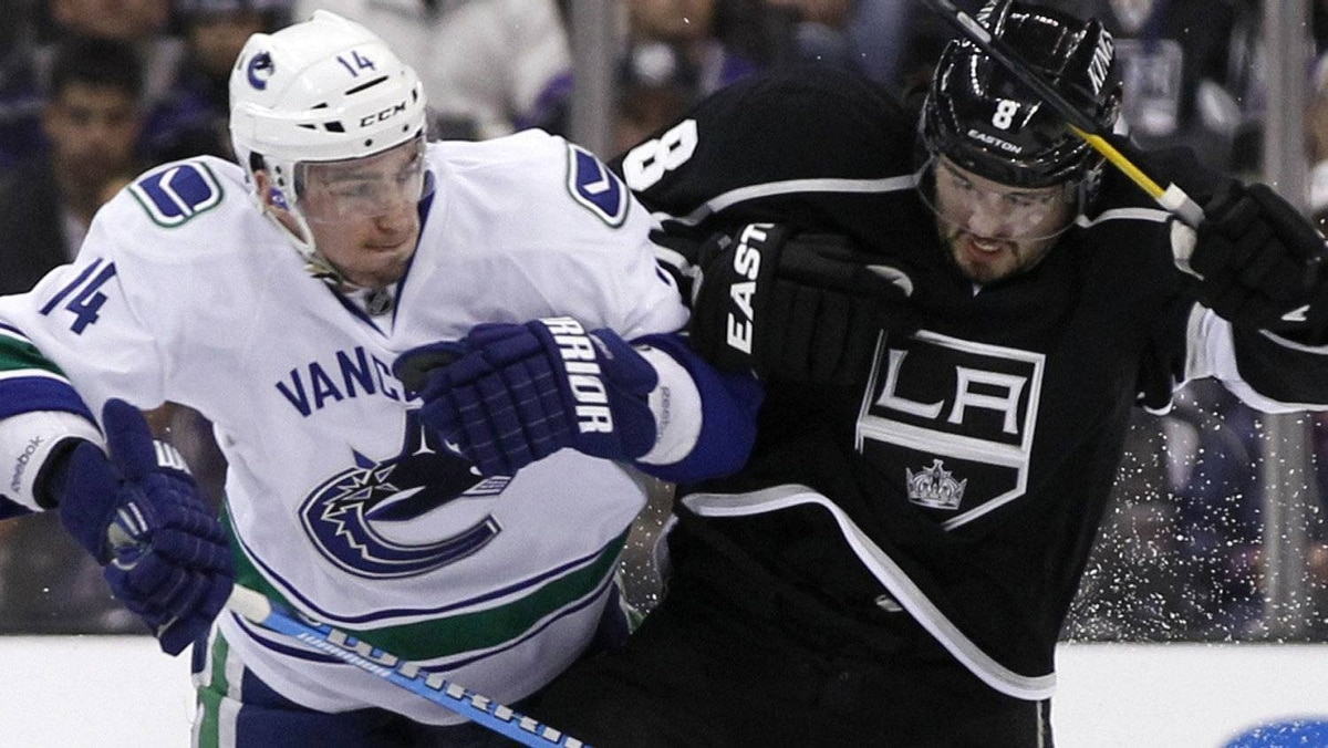 Los Angeles Kings' defenseman Drew Doughty (8) collides with Vancouver Canucks' right wing Alex Burrows (14) during Game 3 of their NHL Western Conference Hockey playoff quarter-finals in Los Angeles, California April 15, 2012. REUTERS/Danny Moloshok