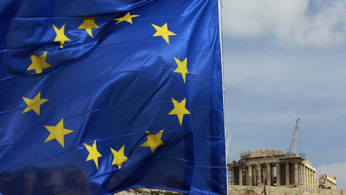 A European Union flag is seen in front of the Parthenon temple in Athens.