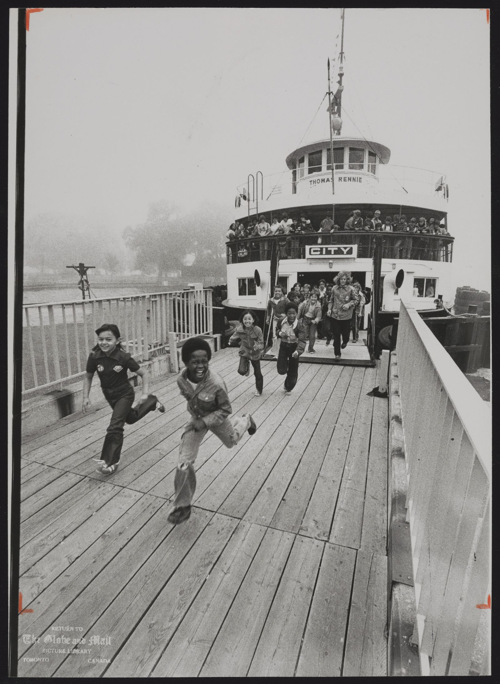 CENTRE ISLAND [Children run as they exit ferry on their arrival at Centre Island, June 28, 1978]