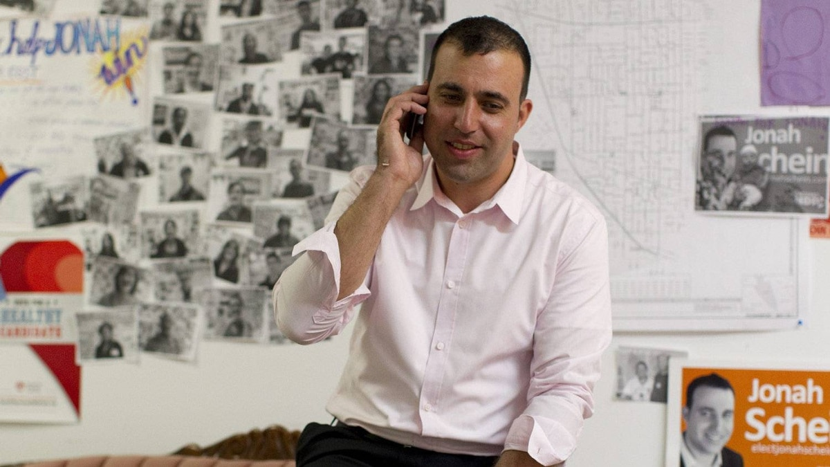 Newly elected NDP MPP Jonah Schein takes a congratulatory phone call from a supporter in his campaign offices in Toronto on Friday October 7, 2011. Schein won the Davenport riding, previously a a long-time Liberal stronghold.