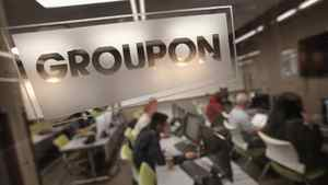 The Groupon logo is engraved in a glass office partition at the company's international headquarters in Chicago.