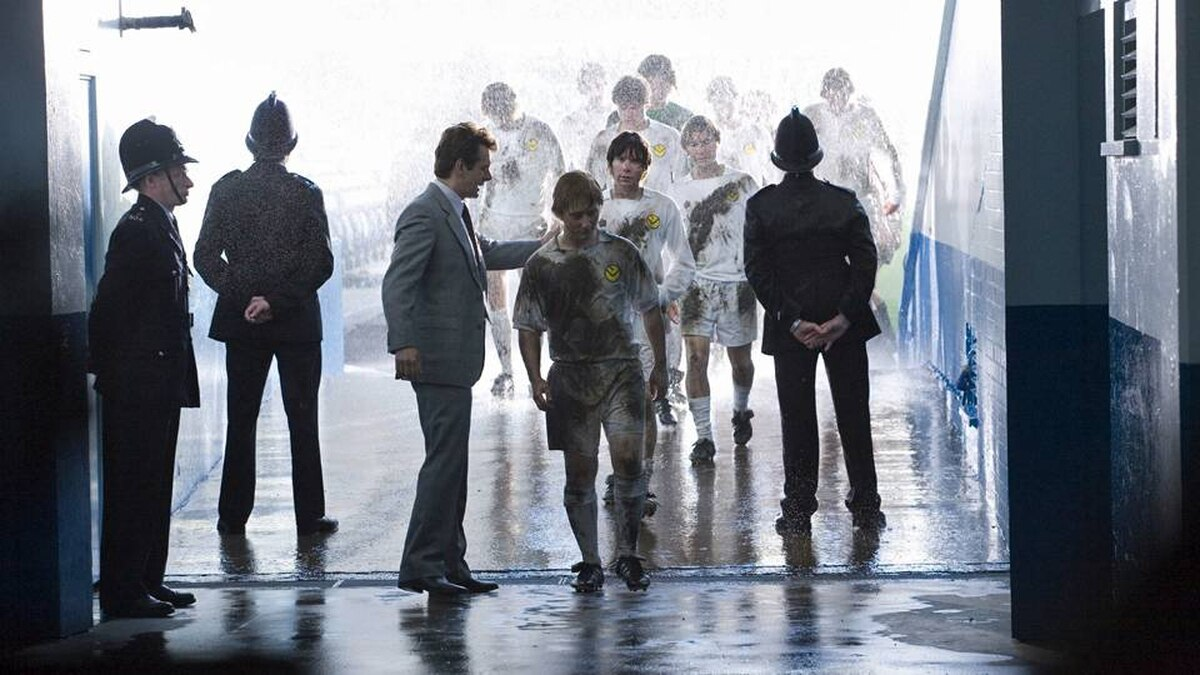 The Damned United tells the story of Brian Clough (Michael Sheen, in suit), who was hired to manage powerhouse Leeds United but was fired only 44 days into the job.