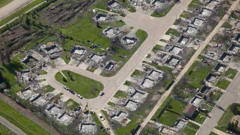 Burned-out homes from May's wildfire are shown in an aerial view of Slave Lake, Alta., prior to the arrival of the Duke and Duchess of Cambridge, July 6, 2011.