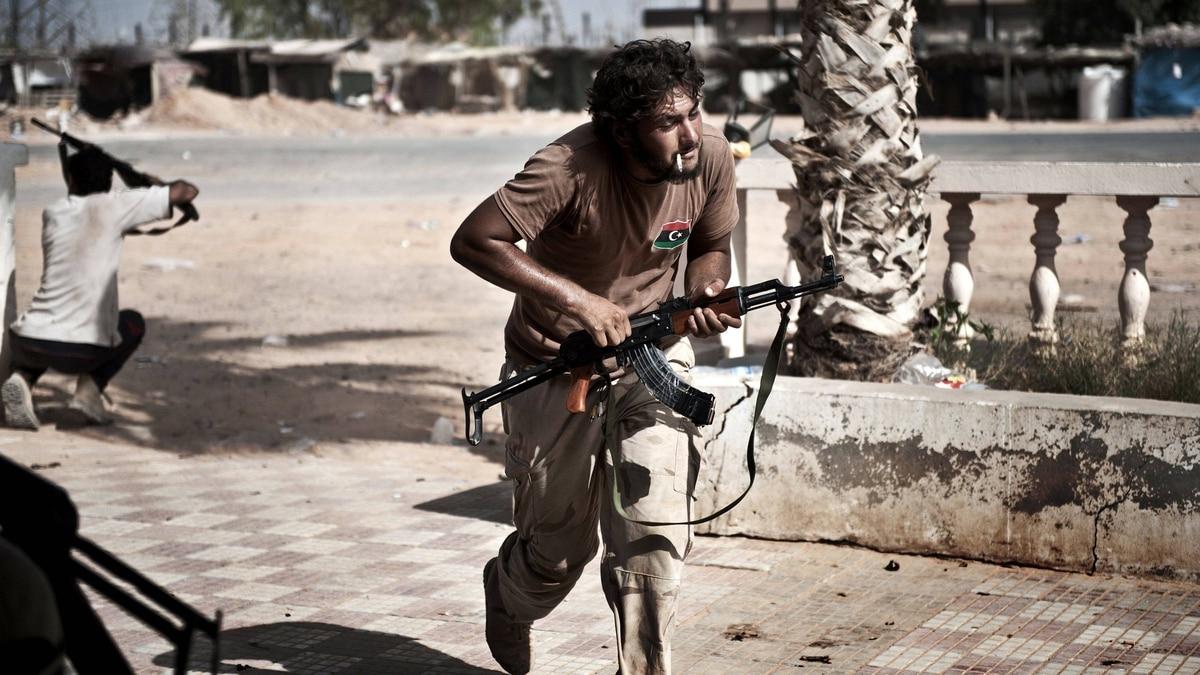 Libyan rebels come under fire from Gadhafi loyalists in Bir Ghanam, southwest of Tripoli.