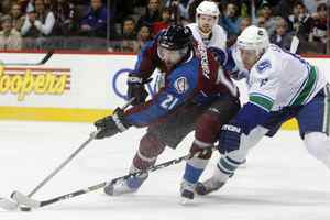 Peter Forsberg, seen in this 2008 file photo battling Vancouver defenceman Sami Salo, is continuing his career with Modo of the Swedish Elite League.