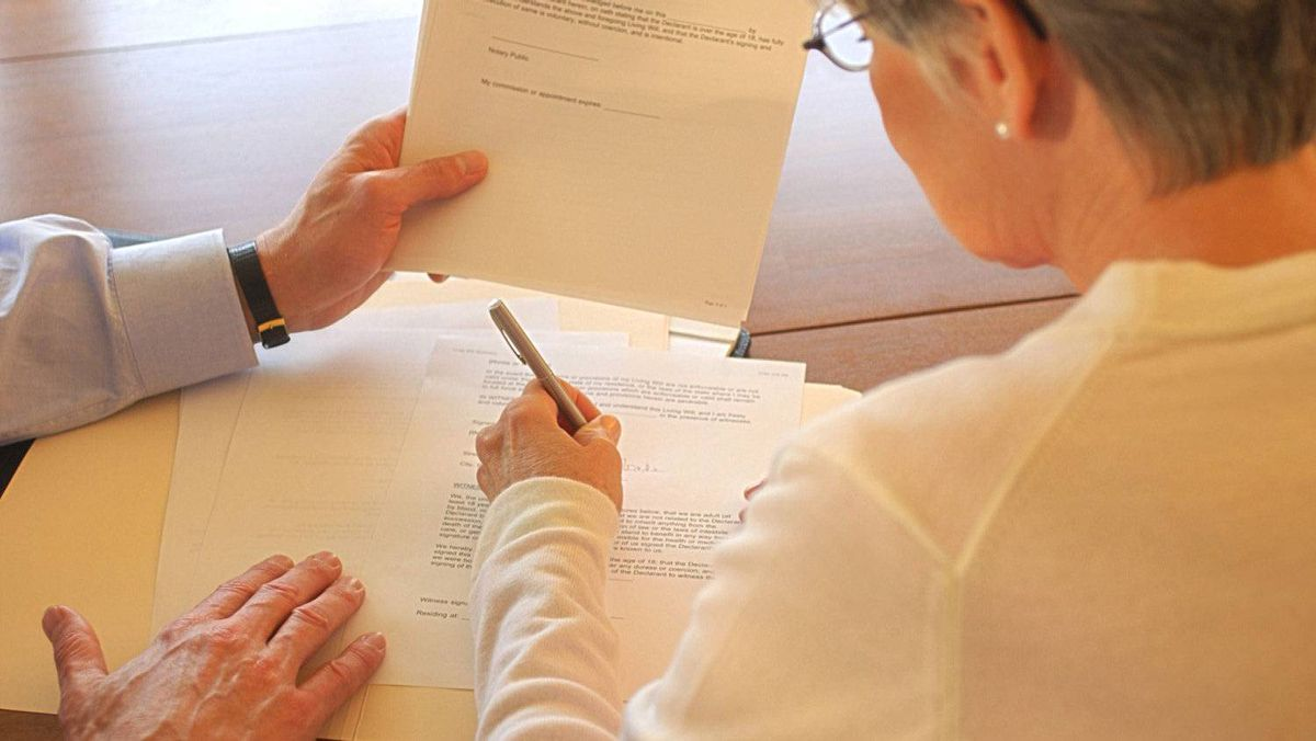 Woman signing paperwork