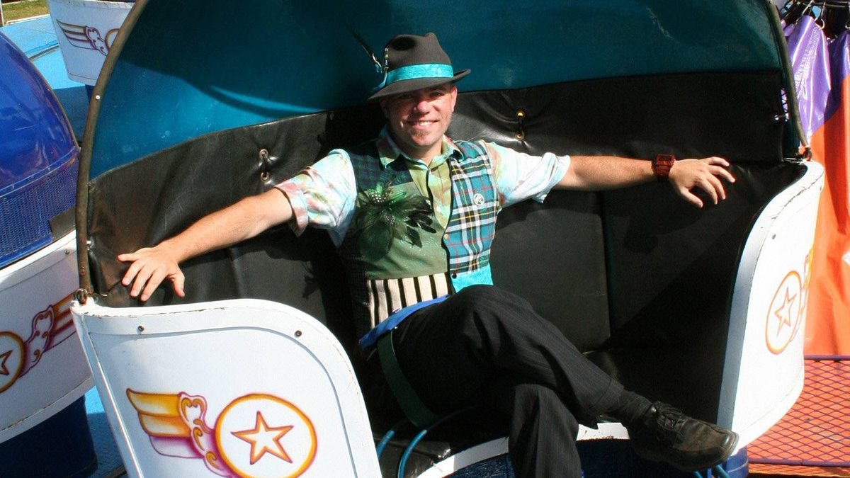 Sustainival founder Joey Hundert, 30, sits in a seat on the Tilt-A-Whirl. All the rides at the Sustainival, which is based in Edmonton, run on electricity made from vegetable oil.