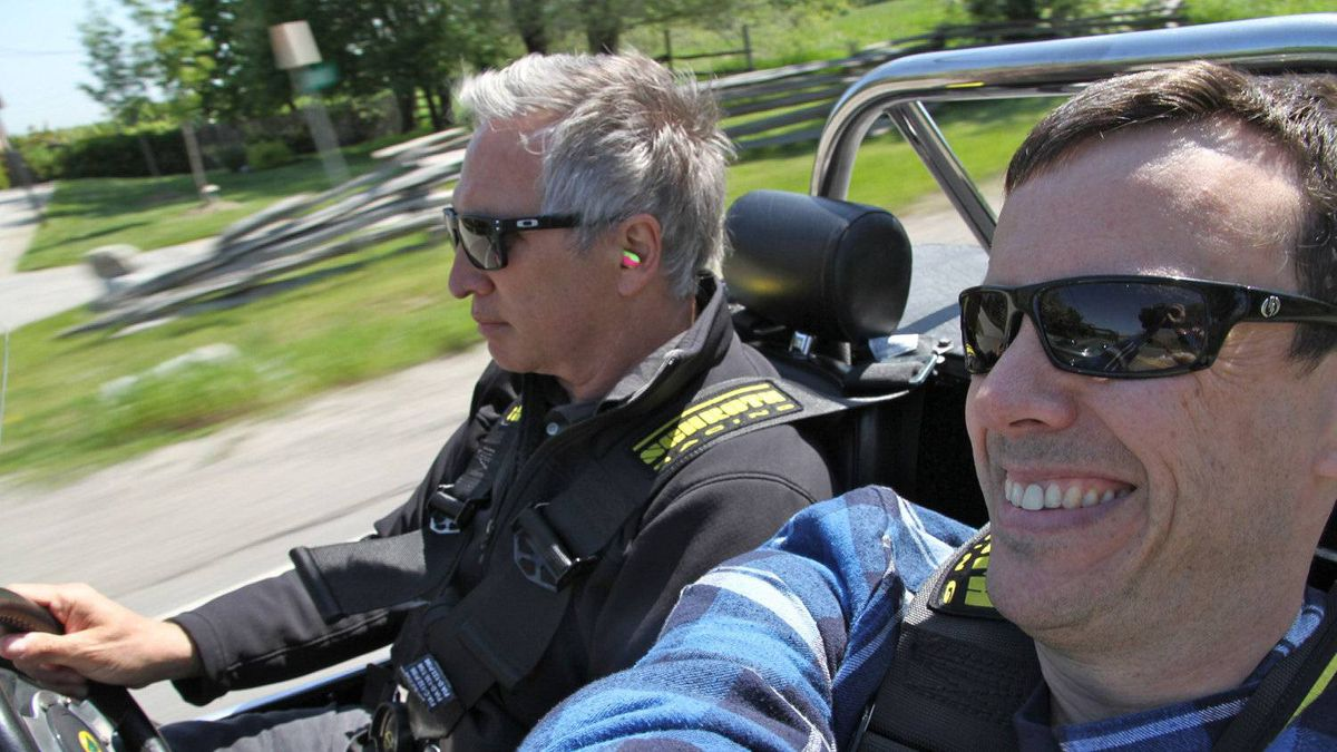 Columnist Peter Cheney (left) and reader Michael Brake drive the back roads in Brake's Caterham Seven convertible.