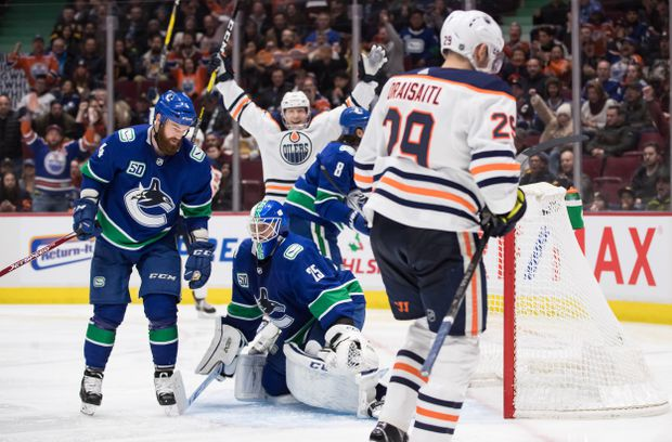 Leon Draisaitl scores twice, leads Oilers over Canucks 3-2