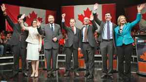 Candidates Martin Singh, Niki Ashton, Thomas Mulcair, Brian Topp, Nathan Cullen, Paul Dewar and Peggy Nash wave to the crowd during the final NDP leadership debate in Vancouver on March 11, 2012.