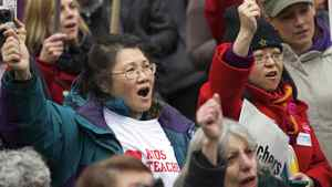 Demonstrators react while listening to BC Teachers' Federation President Susan Lambert speech during a teachers rally at the Vancouver Art Gallery in Vancouver, British Columbia March 7, 2012.