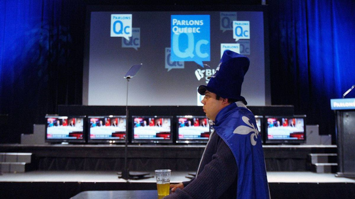 Bloc supporter Richard Bourdeau, of Sorel, Quebec sits in a close to empty room early Monday, May 2, 2011 at the Bloc Quebecois election night headquarters in Montreal.