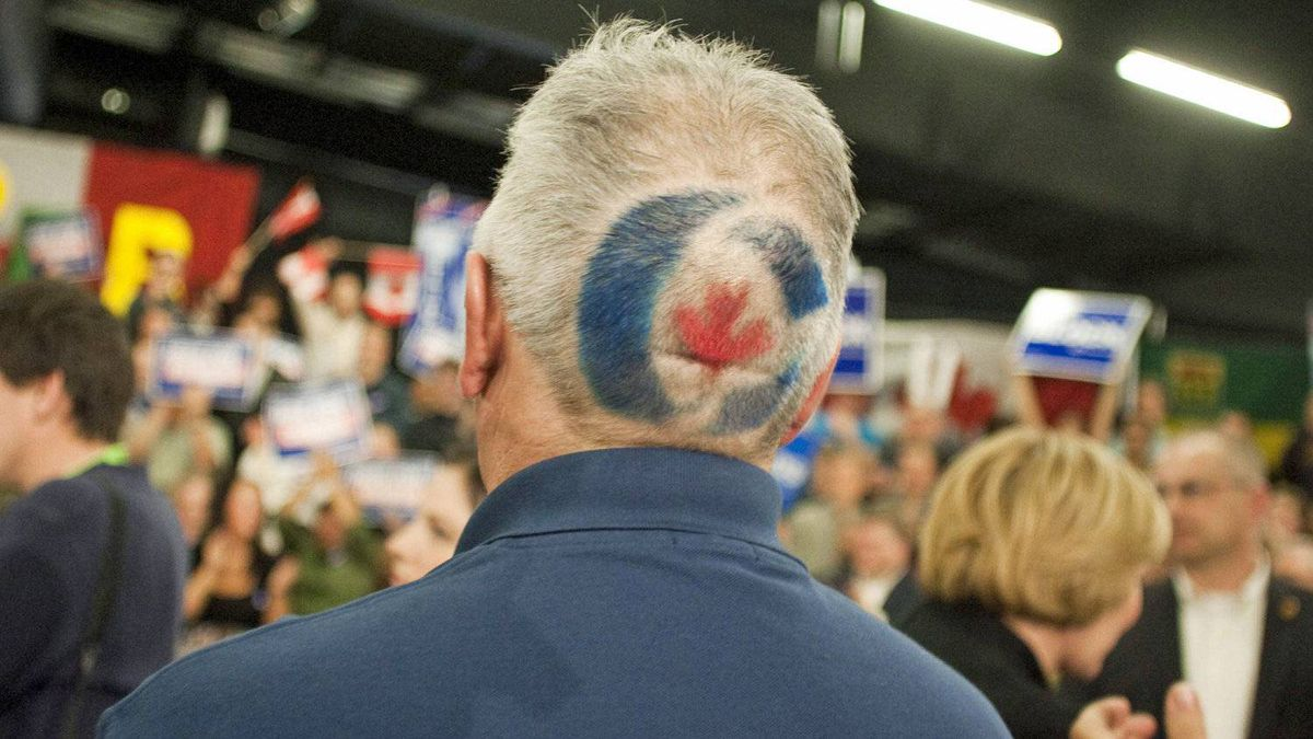 A Conservative Party supporter waits for Stephen Harper to speak at a campaign stop in Saskatoon on April 15, 2011.