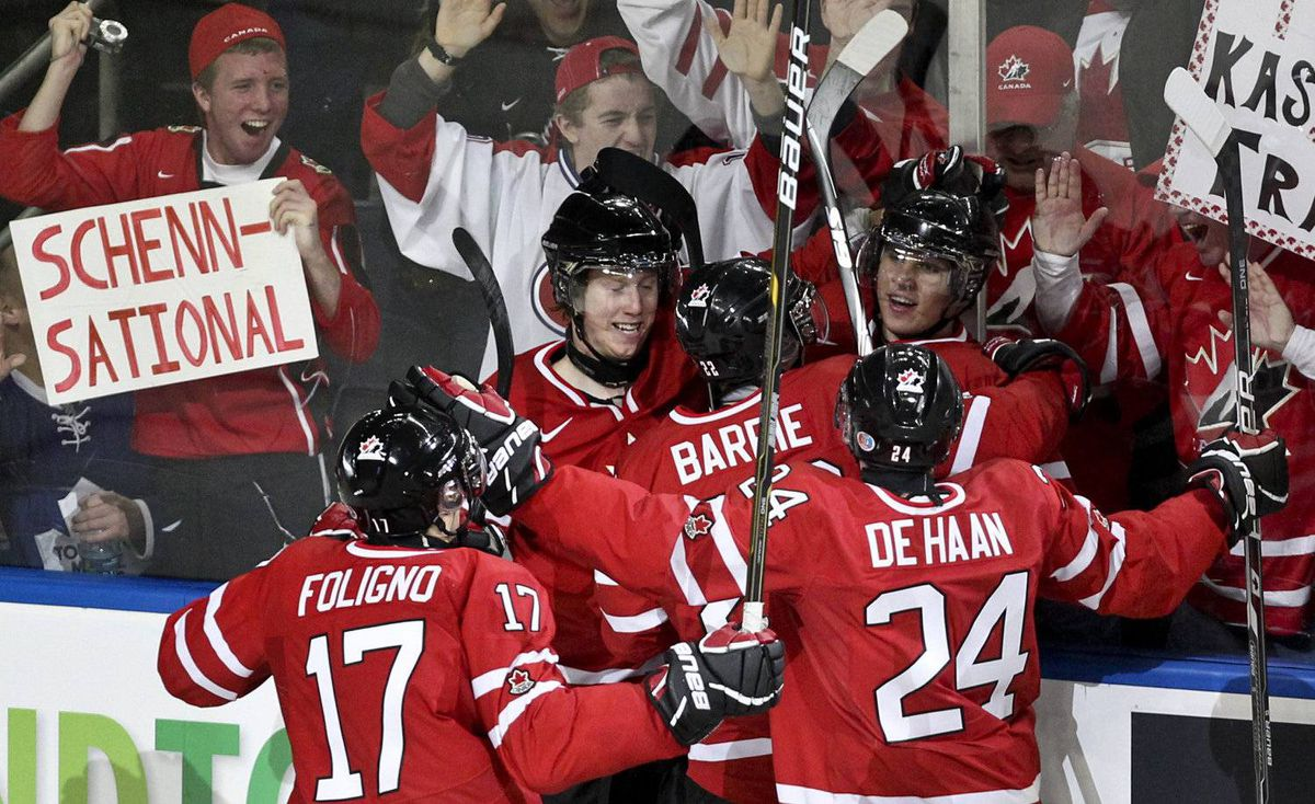 Team Canada's Brayden Schenn, centre, celebrates his second period goal against Team Russia with teammates, Marcus Foligno, left to right, Tyson Barrie and Calvin de Haan during the gold medal game of the World Junior Hockey Championships in Buffalo, N.Y. on Wednesday January 5, 2011.