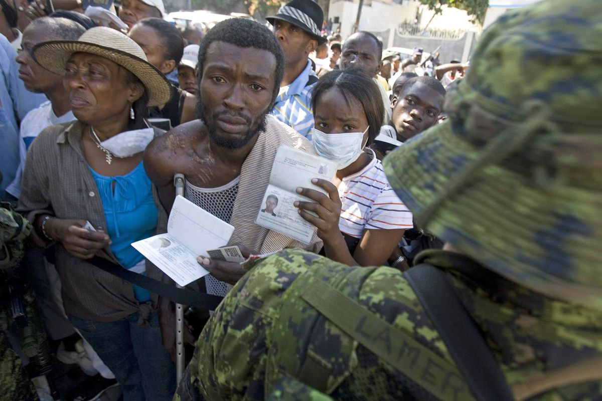 Haitians crowd around the Canadian embassy in Port-au-Prince on Monday, Jan. 18, 2010, hoping for some kind of assistance.