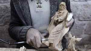 A Palestinian wood carver works on a Christian religious figure, made out of olive wood, in a factory in the West Bank town of Bethlehem, ahead of Christmas December 23, 2011.