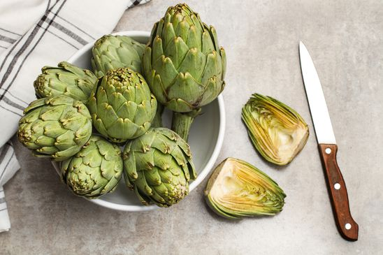 How do you cook and eat artichokes?