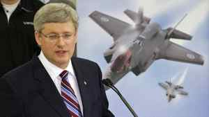 Prime Minister Stephen Harper speaks to employees at a Waterloo, Ont., firm that manufactures accessories for the F-35 fighter jet on March 11, 2011.