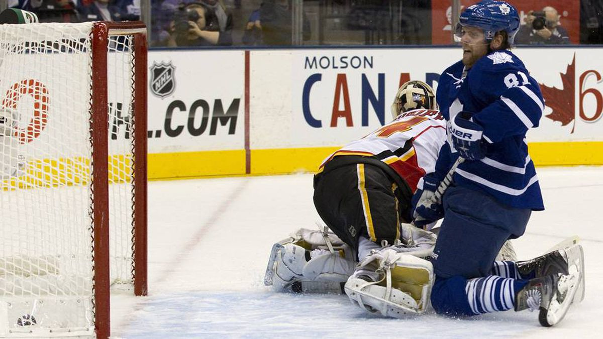 Toronto Maple Leafs' Phil Kessel scores on Calgary Flames goalie Miika Kiprusoff during second period NHL hockey action in Toronto on Saturday.