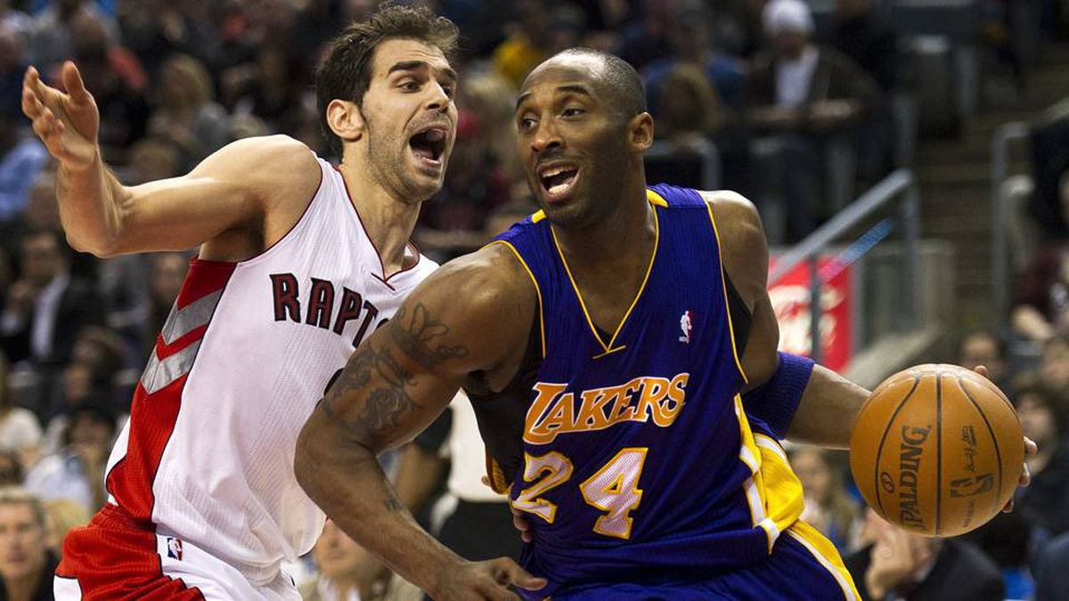 Toronto Raptors guard Jose Calderon, left, battles for the ball with Los Angeles Lakers guard Kobe Bryant, right, during first half NBA basketball action in Toronto on Sunday.
