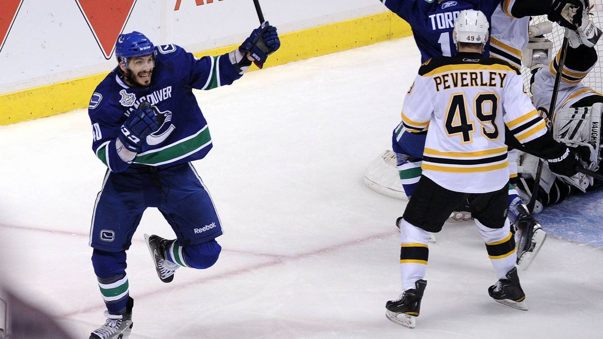 Maxim Lapierre #40 of the Vancouver Canucks celebrates after scoring a goal in the third period.