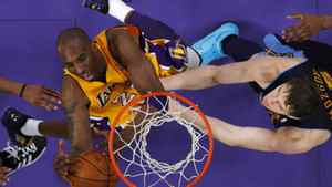 Los Angeles Lakers' Kobe Bryant goes up to shoot past Denver Nuggets' Timofey Mozgov of Russia during Game 7 of their NBA Western Conference basketball playoff series in Los Angeles, California May 12, 2012.