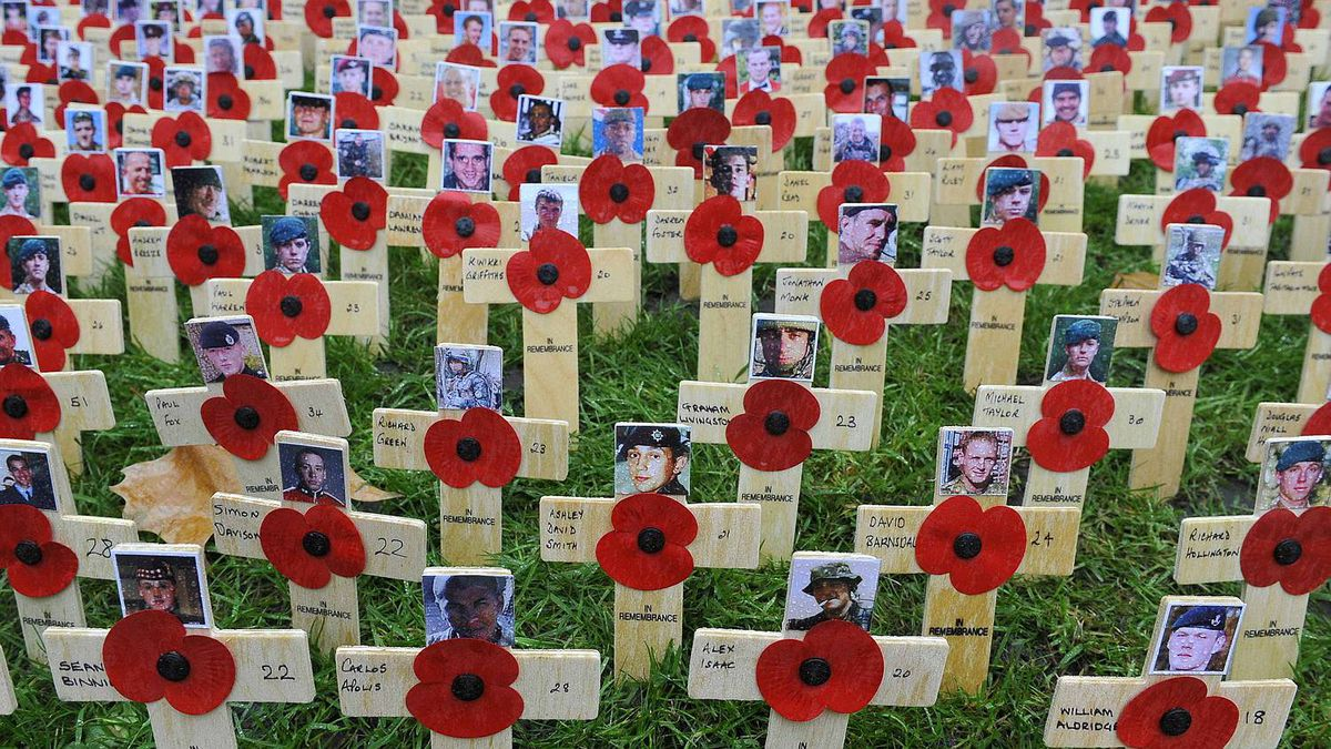 Photographs of soldiers killed on duty in Afghanistan are seen attached to replica crosses at a Field of Remembrance outside Westminster Abbey in central London Nov. 11, 2010.